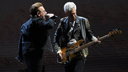 Bono seems to spill the beans on Adam Clayton's baby news on stage in London