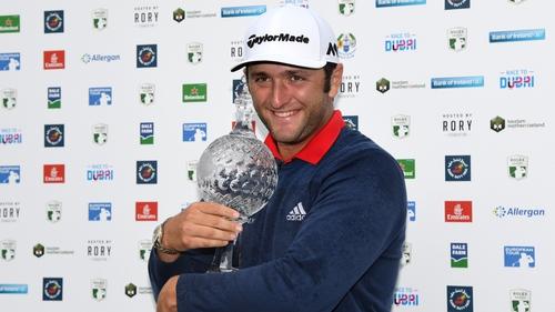 Jon Rahm wraps his arms around the Irish Open trophy