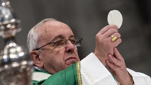 Pope Francis holds aloft the Eucharist during a mass in St Peter's Basilica