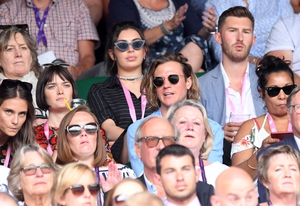 Charli XCX sat behind Sam Rollinson and Dougie Poynter. Charli and Dougie accesorised with some statement sunglasses.