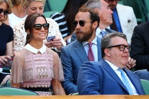 Pippa Middleton chose a pink lace panel dress from Self-Portrait while her brother James chose a dapper blue suit.
