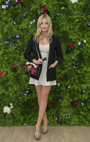 Laura Whitmore hosts a Wimbledon event wearing a simple pale dress, black blazer and checked Pinko bag with the slogan 'Love Me Tender'.
