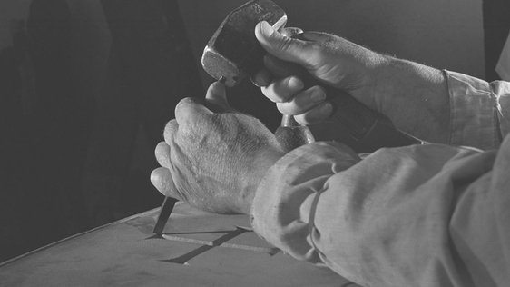Sculptor Seamus Murphy's hands at work