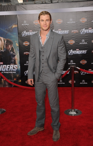 Hairbun and a grey suit are the winning combo for Chris Hemsworth at the 'The Avengers' premiere in 2012.
