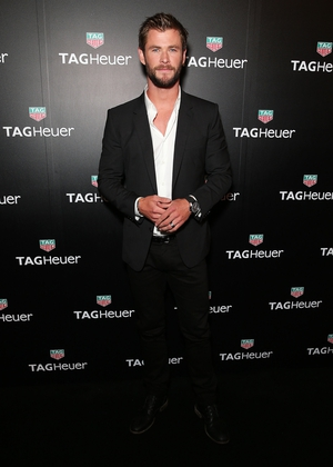 Also a dapper ambassador for the Tag Heuer brand, Chris Hemsworth is wearing an all black look for the Australian launch of Heuer 01 in 2016.
