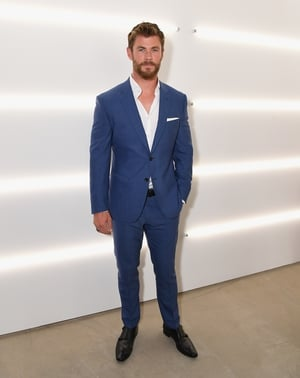 This blue suit matches the actor's eyes and we're melting... Chris Hemsworth was attending the BOSS Menswear show yesterday in New York.