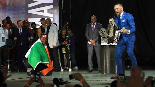 Conor McGregor's custom suit is trolling at its finest
