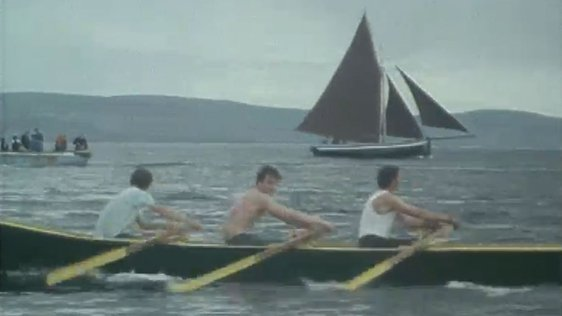 Johnny Jimmy An Oileáin and his team in currach race, An Spidéal (1987)