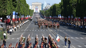 The parade makes its way along the Champs-Elysees