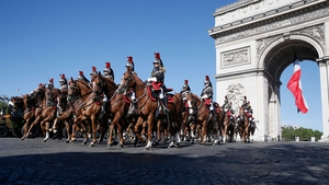 French Mounted Republican guards ride past the Arc de Triomphe