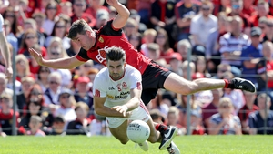 Peter Turley collides with Tyrone's Tiernan McCann