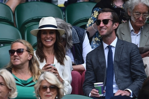 Pippa Middleton and husband James Matthews sat in the Royal box on Centre Court. We love Pippa's white panama.