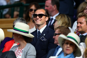 Jude Law looks on from the centre court on day eleven of the Wimbledon Lawn Tennis Championships at the All England. We're loving those sunglasses.