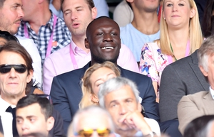 Stormzy looks smart in a grey suit while attending Wimbledon.