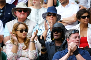 Grace Jones watches the action on centre court wearing some Winter accessories.