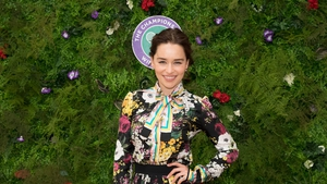 Game of Thrones Emilia Clarke wore a beautiful printed dress with floral detailing to the tennis tournament.
