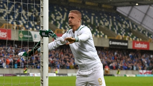 Leigh Griffiths tying a Celtic scarf to a Windsor Park goalpost after Friday's 2-0 win over Linfield