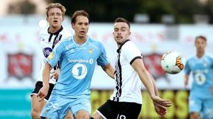 Dundalk's Robbie Benson (R) in action against Anders Konradsen of Rosenborg