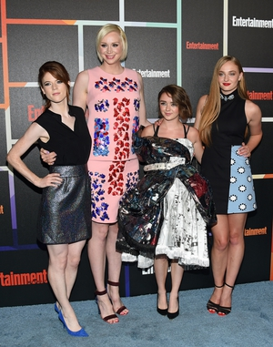 Rose Leslie, Gwendoline Christie, Maisie Williams and Sophie Turner attend Entertainment Weekly's Comic-Con in 2014. Sophie wore a Matthew Williamson number while Maisie's dress was made out of recycled graphic novels.