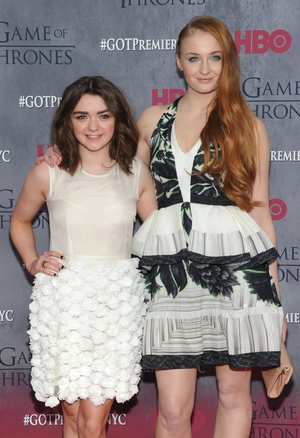 Stark sister style. Maisie and Sophie attend the 'Game Of Thrones' Season 4 premiere in 2014 dressed in white.
