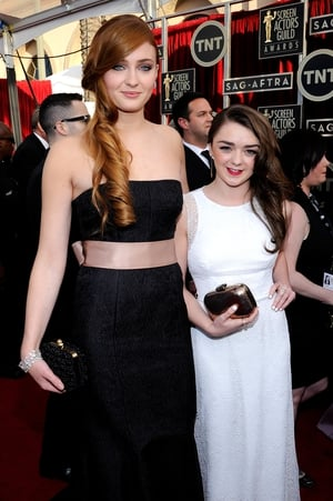 Working the SAG red carpet in 2014. Sophie wore a Dolce & Gabbana gown while Maisie wore a beautiful white dress.