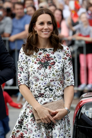 The Duchess accessorised her look with a clutch bag from Poland's Etui Bags and a Cartier watch.