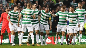 Celtic's Tom Rogic celebrates the second goal with Scott Brown