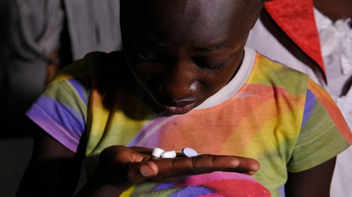 A young Kenyan girl takes her antiretroviral drugs - African countries have made great progress in fight against AIDS
