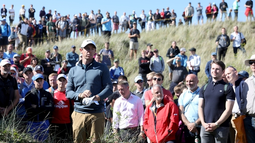 Rory McIlroy ended day one six shots behind the leaders