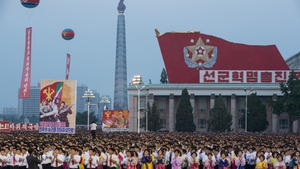 North Koreans stand in formation during celebrations marking the 4 July launch of the Hwasong-14 intercontinental ballistic missile
