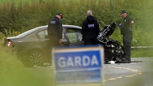 Gardaí examine a car following a crash in Co Louth in which three women died