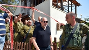 Israeli Defense Minister Avigdor Liberman visits the site of the stabbing in Neve Tsuf