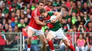 Cork's James Loughrey tackles Andy Moran of Mayo