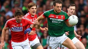 Cork's Tomas Clancy tackles Tom Parsons of Mayo