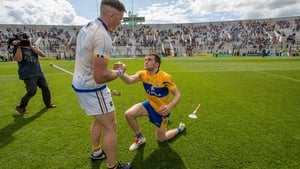 Tipperary's Padraic Maher commiserates with Clare's Shane O'Donnell after the game