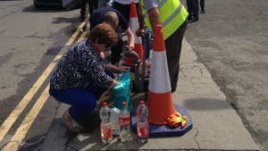 Members of the public queue up at a temporary water station in Drogheda