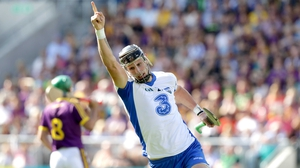 Waterford's Maurice Shanahan celebrates scoring a point