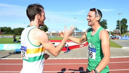 Paul Byrne congratulates his training partner Tom Barr after their 400m hurdle race
