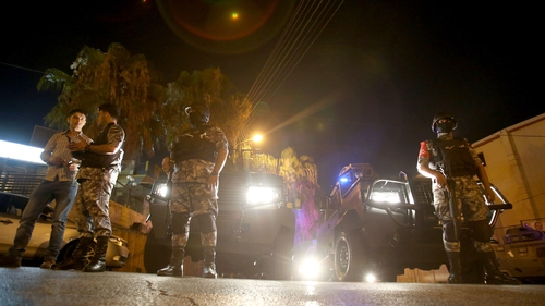 Security forces outside the Israeli embassy in Jordan