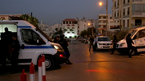 Jordanian security forces stand guard outside the Israeli embassy in Amman