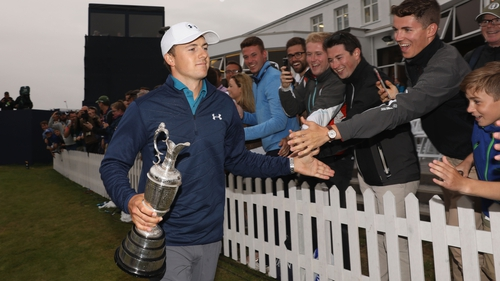 Jordan Spieth with the claret jug behind the 18th green at Royal Birkdale on Sunday
