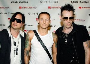 Heavily tattoo'd musicians Amir Derakh, Chester Bennington and Ryan Shuck attend the grand opening of Club Tattoo in 2009
