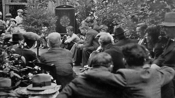 Neighbours gathered at the house of Christy O'Riordan  to hear the 1933 All-Ireland Senior Hurling Final on Radio Éireann.