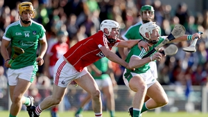 Eoghan Murphy with Cian Lynch battle for possession