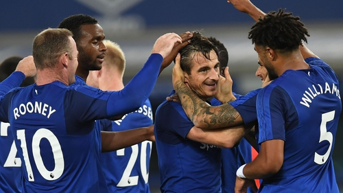 Leighton Baines is congratulated by his team-mates after breaking the deadlock
