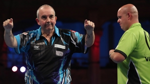 Phil Taylor stunned the world number one Michael van Gerwen (pic Lawrence Lustig PDC)