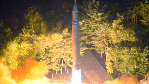 A photo made available by the North Korean Central News Agency (KCNA) shows the second test-fire of the ICBM at an undisclosed location in North Korea yesterday