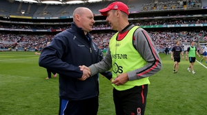 Monaghan manager Malachy O'Rourke (L) and Down boss Eamonn Burns after the game