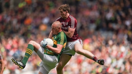 Kerry's Kieran Donaghy with David Walsh of Galway