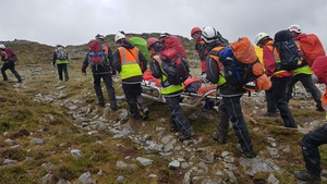A casualty is stretchered off the mountain by medical staff (Pics: Mayo Mountain Rescue)